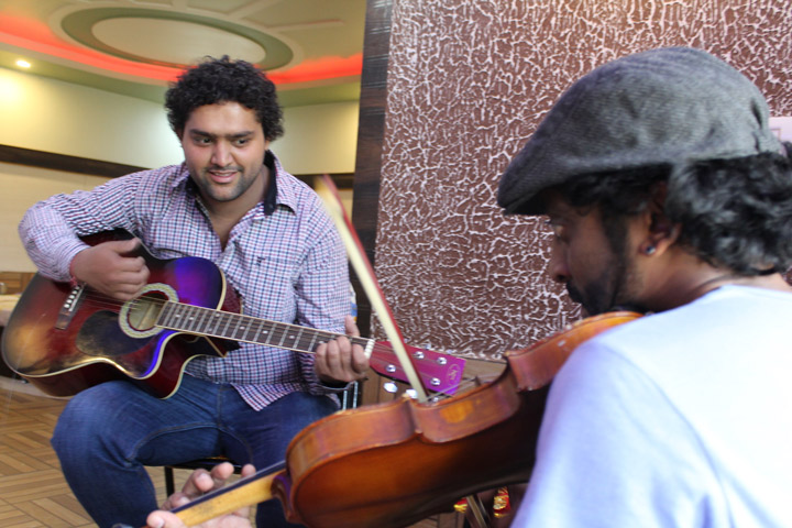 Hezron learning a new style of music from Manoj called Pahari